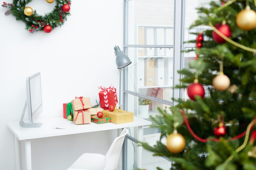 Business workplace with gift-boxes on Christmas day